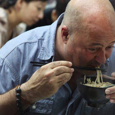 Andrew Zimmern eating noodles