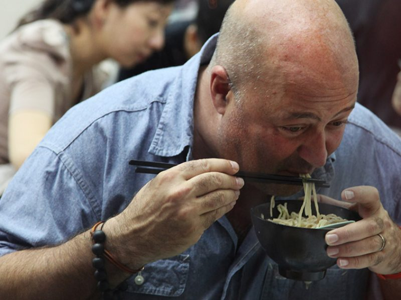 Andrew Zimmern eating noodles