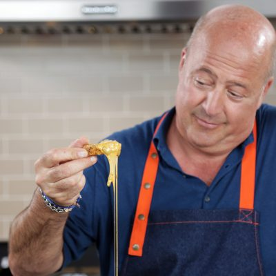 Andrew Zimmern's Corn Pones with Cheese Sauce