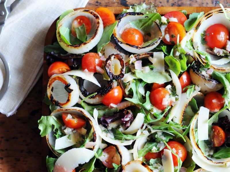 Andrew Zimmern' Grilled Onion Salad with Arugula